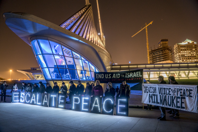 Scene of the protest outside the Milwaukee Art Museum. Photo courtesy of Joe Brusky, Overpass Light Brigade