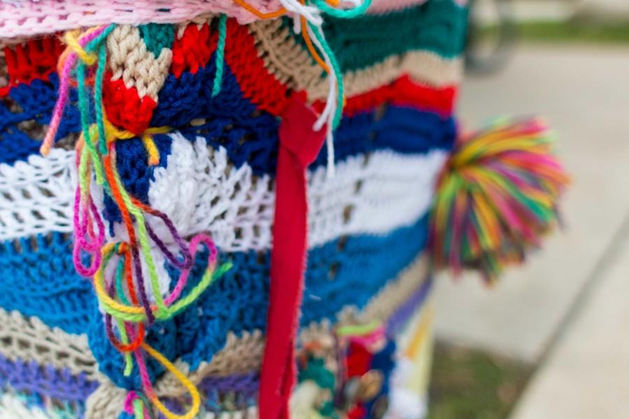 The trash can yarn bomb is made from assembled pieces and titled