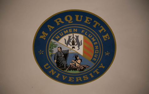 The Marquette seal, which features a cropped version of a painting depicting Jacques Marquette and a group of Native Americans, has sparked controversy over its revisionism.