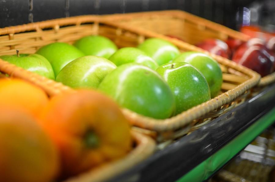 Organic produce in the baskets includes apples, bananas, potatoes and seasonal vegetables. Photo by Matthew Serafin / matthew.serafin@marquette.edu