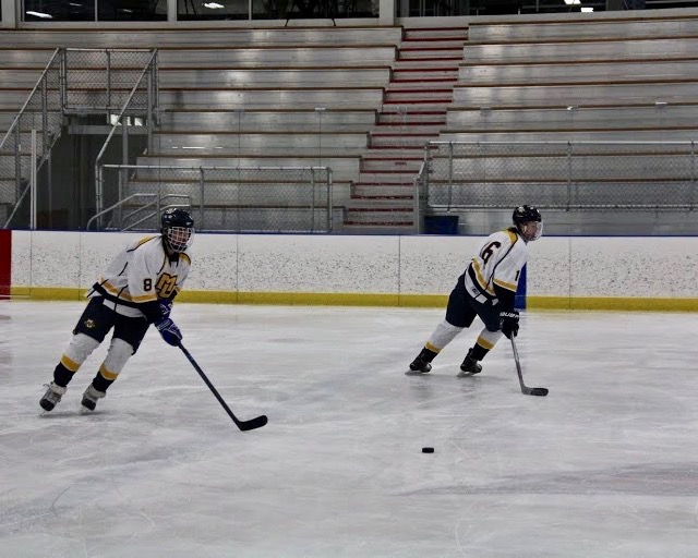Graduate student Chrisitan Leathley (left) is enjoying his last rendezvous of competitive hockey. Photo by Jamey Schilling/andrew.schilling@marquette.edu