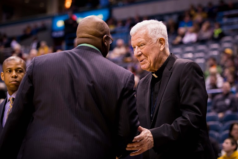 Rev. John Laurance typically arrives an hour and a half before home games to watch shoot around and interact with the Marquette community. Photo by Ben Erickson/benjamin.a.erickson@marquette.edu