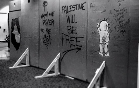 The mock apartheid wall before it was removed. Photo via https://www.facebook.com/SJPatMU/