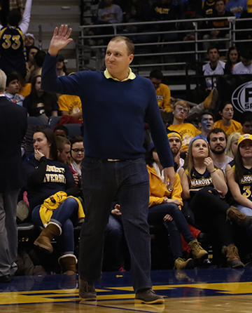 Mike Van Sickle waves to the crowd at the BMO Harris Bradley Center on Saturday night at the Marquette Men's Basketball game.
