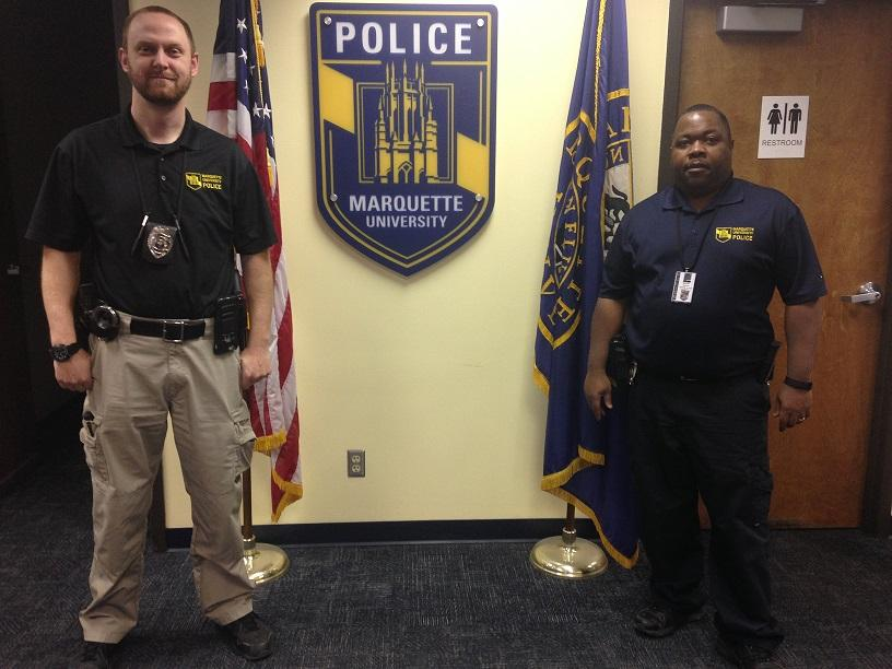 Rob+Krystowiak+%28right%29+and+Billy+Ball+%28left%29+discuss+their+roles+as+MUPD+detectives.+Photo+by+Ryan+Patterson%2Fryan.patterson%40marquette.edu