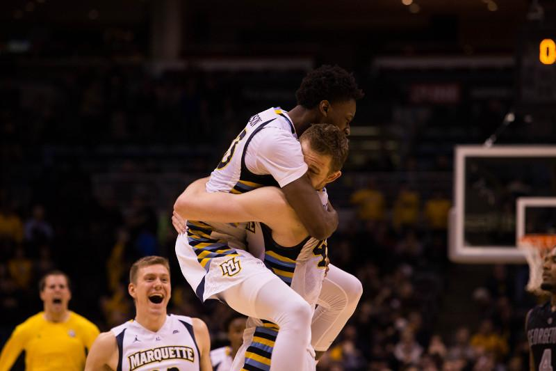 Luke Fischer and Jajuan Johnson celebrate following the final buzzer (Photo by Meredith Gillespie)