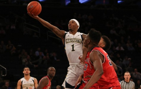 Marquette survives late St. John's rally to advance in BIG EAST Tourney
