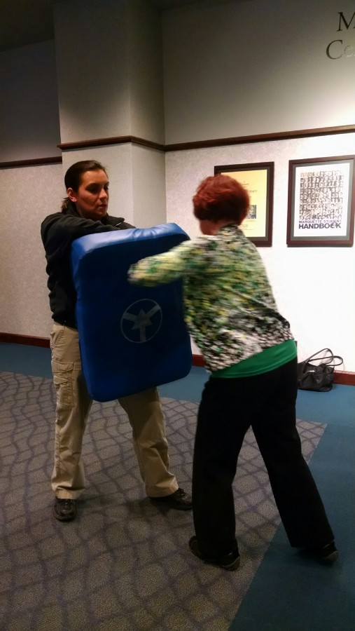 Victoria Fitzgerald (right) was one of three participants of this months self-defense class, which are led by Capt. Ruth Peterson (left). Photo by Alex Groth/alexandria.groth@marquette.edu