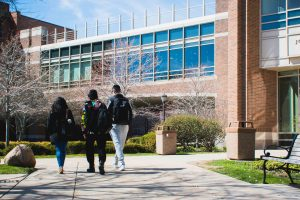 Students walking near the library.