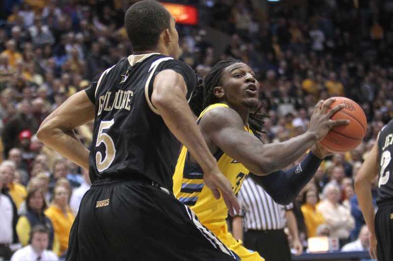 Jae Crowder faces tough defense from Vanderbilt in the schools' last meeting, Dec. 29, 2011.