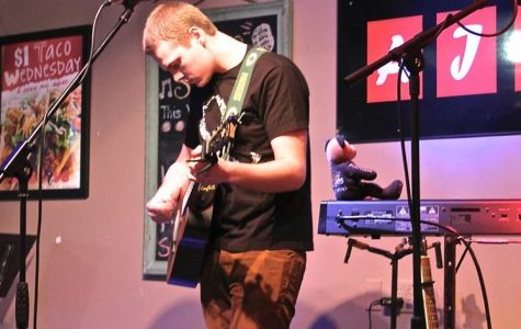 Max Templin, guitarist and Marquette music sensation, prepares for a performance this coming Thursday. He is one of four performers featured at the Union Sports Annex.
