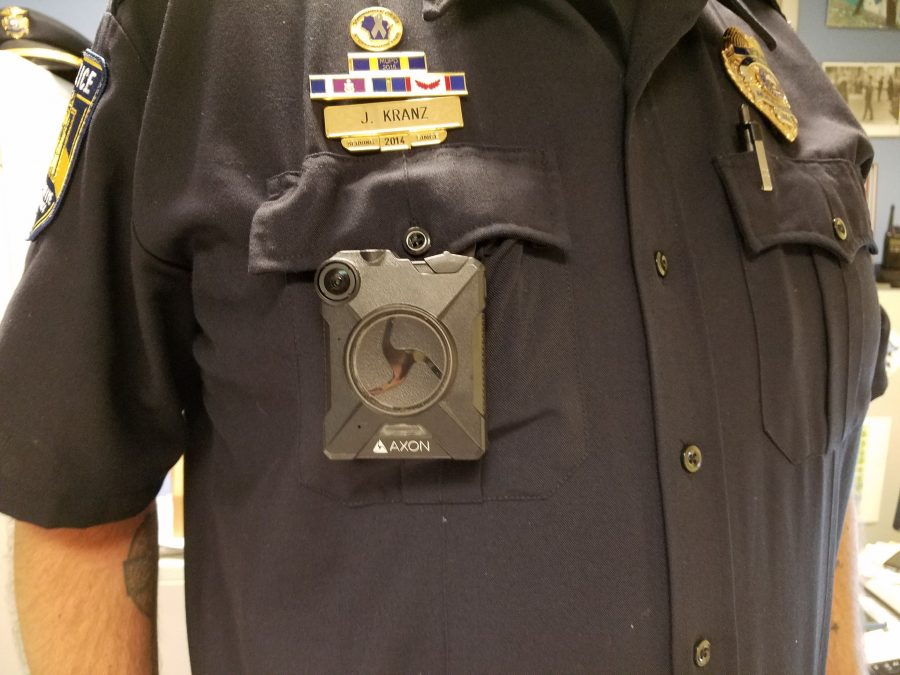 The Axon body camera fits on an officer's front pocket.