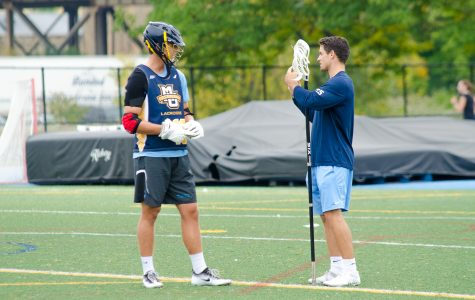Jake Richard teaches a Marquette defenseman during the team's intersquad scrimmage last week.
