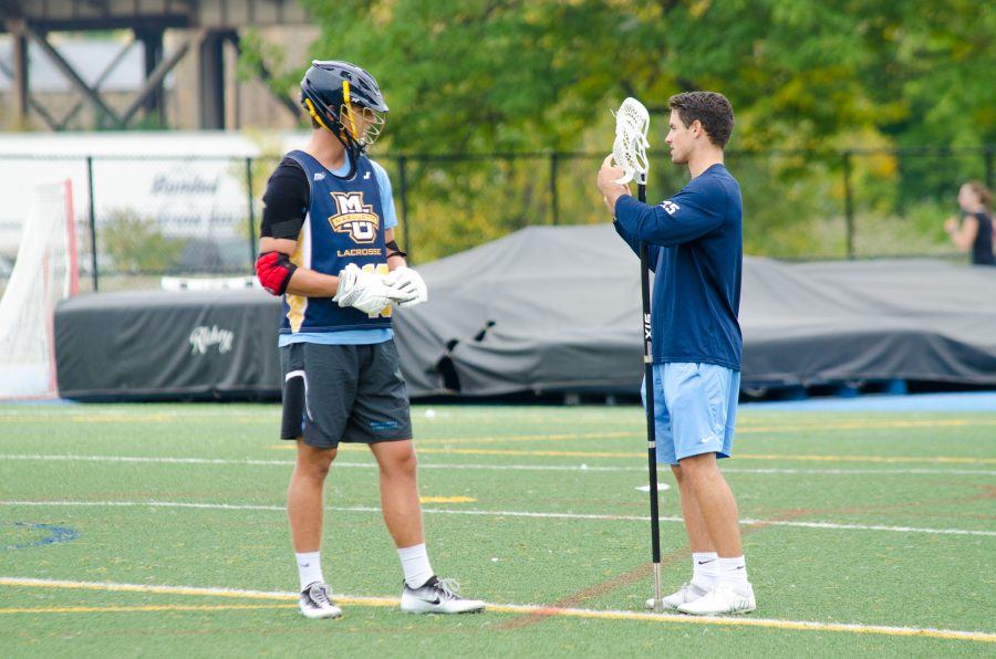 Jake+Richard+teaches+a+Marquette+defenseman+during+the+team%27s+intersquad+scrimmage+last+week.