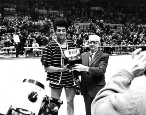 Dean Meminger holds his NIT Most Valuable Player trophy with Herbert Sutter, the president of the Metropolitan Intercollegiate Basketball Association.