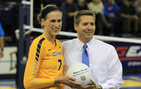 Head coach Ryan Theis stands with Meghan Niemann to honor her new record.