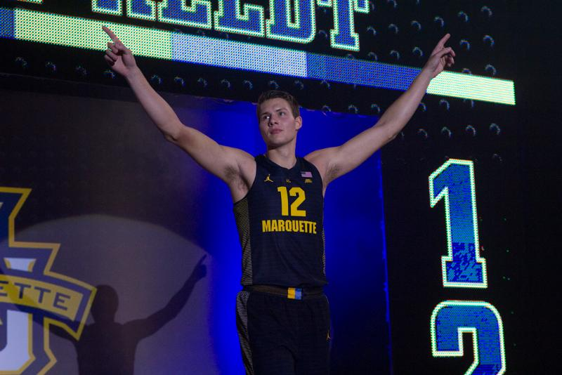 Men's basketball unveiled their new blue uniform at Marquette Madness Friday.