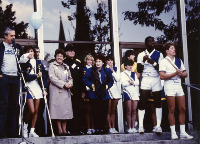 Cheerleaders and other members of the Marquette community listen to a speaker during homecoming festivities, 1985.