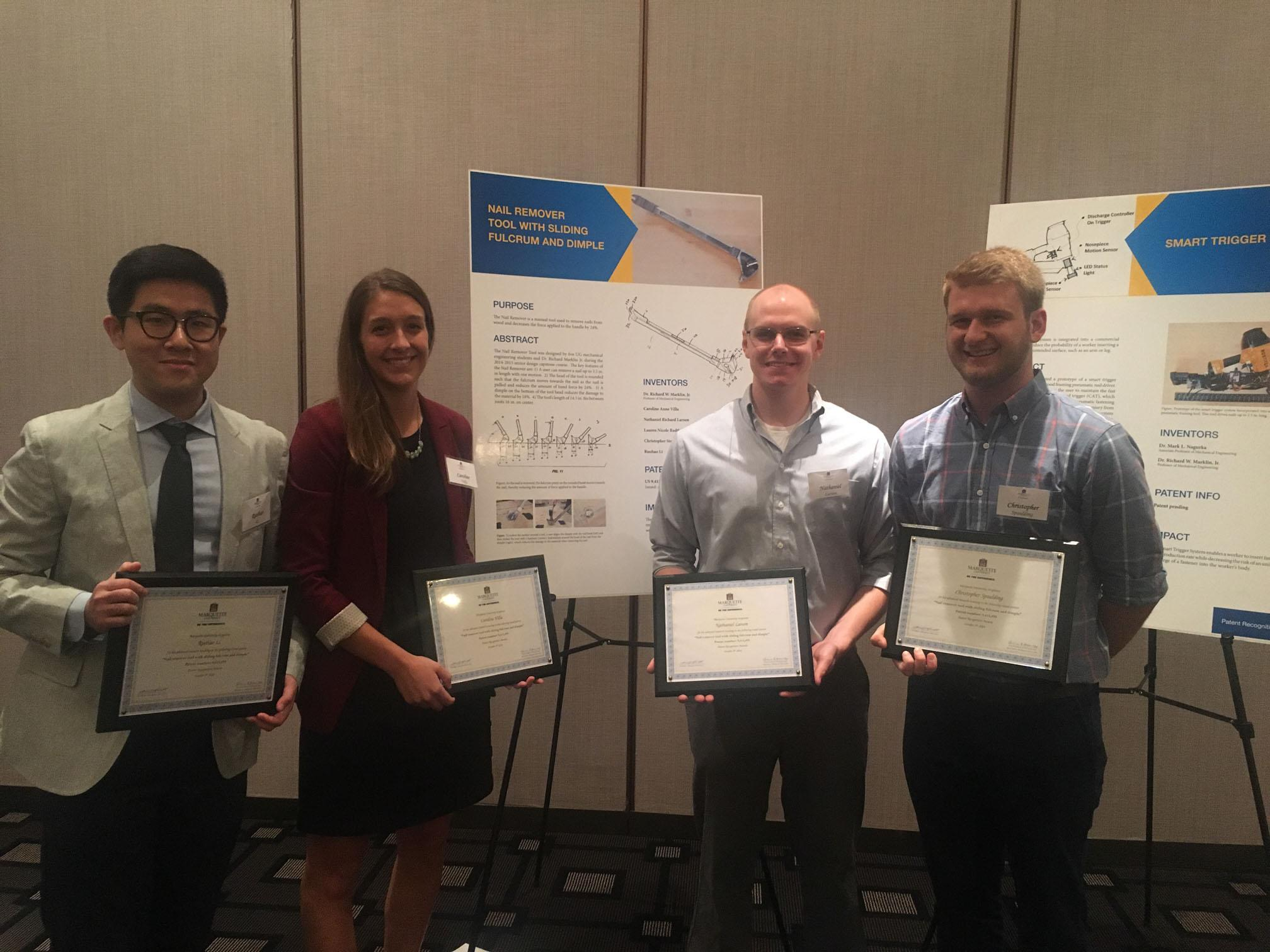Engineering students Ruohao Li, Caroline Villa, Nathaniel Larson and Christopher Spaulding receive their patent recognition award.