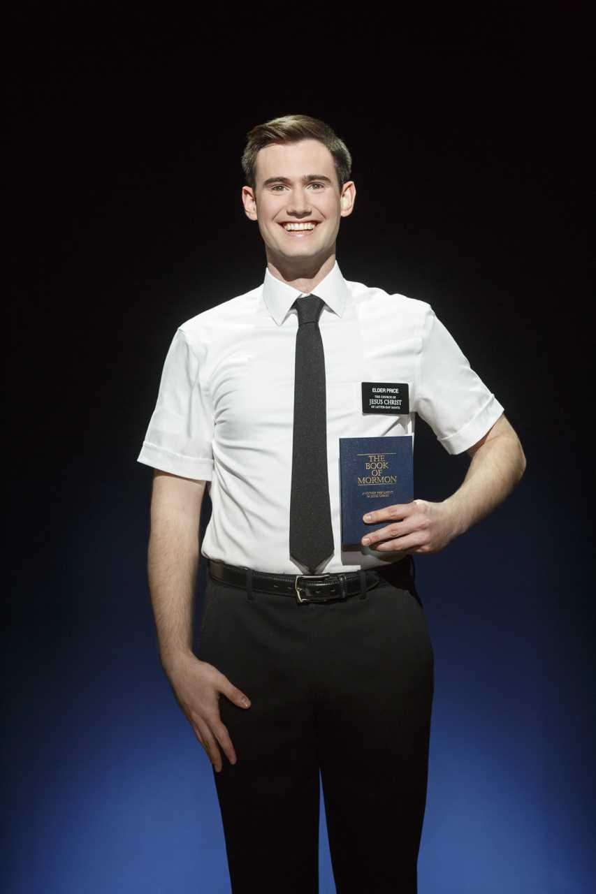 Ryan+Bondy+%28Elder+Price%29+displays+the+Book+of+Mormon.