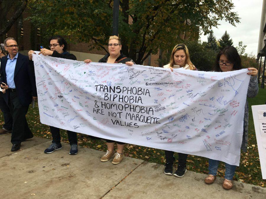 Members of the Marquette community gather to counter protest The American Society for the Defense of Tradition, Family and Property. Who argue Marquette's policy on transgenders does not align with its Jesuit and Catholic roots.