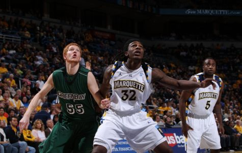 Jae Crowder boxes out a Green Bay player in a game in 2010.