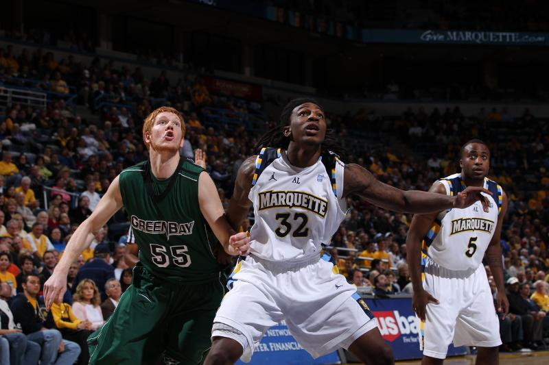 Jae+Crowder+boxes+out+a+Green+Bay+player+in+a+game+in+2010.