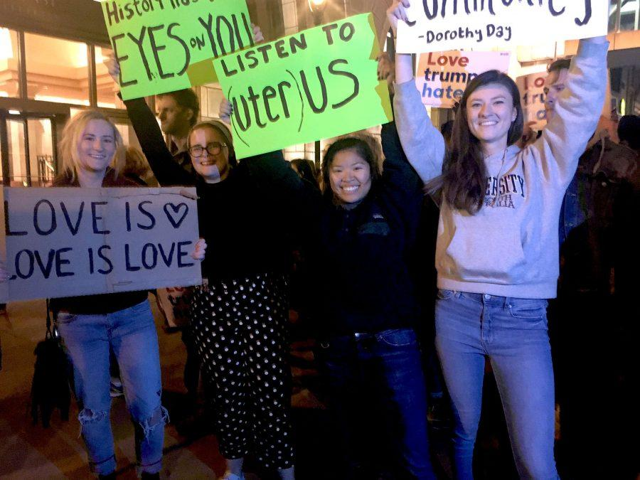 Left to right: Marquette students Lili Erickson, Hannah Seeman, Melissa Alburo, Olivia attend anti-Trump protest in Milwaukee Thursday night. *Olivia did not wish to give her last name