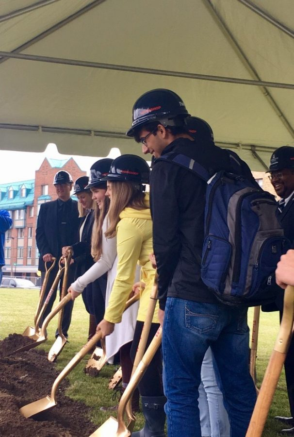 Students take part in groundbreaking ceremony in the field in front of O'Donnell Hall