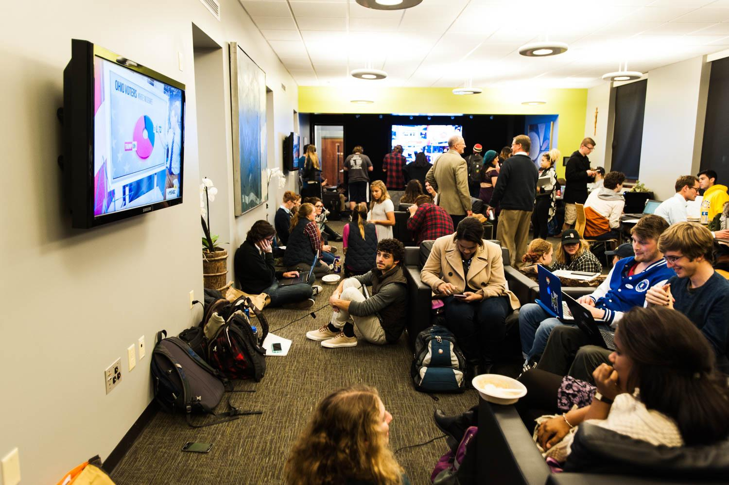 Several hundred students migrated in and out of the jPad in Johnston Hall for the Democratic viewing party, waiting anxiously to hear the presidential results. Photo by Mike Carpenter/michael.carpenter@marquette.edu