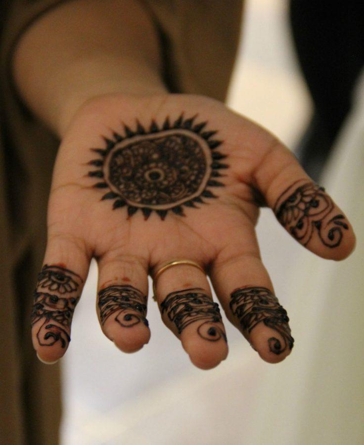 Freshman Nadia Malik shows off her new henna tattoo.