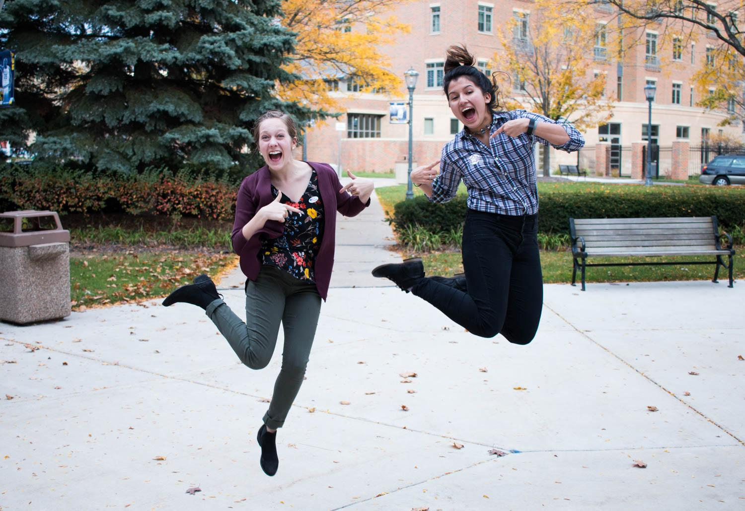 Rebecca Kaiser, left, a senior in the College of Arts & Sciences and Jacquelyn Carpenter, a junior in the College of Arts & Sciences, jump for joy after voting in their first presidential election. Photo by Meredith Gillepsie/meredith.gillepsie@marquette.edu