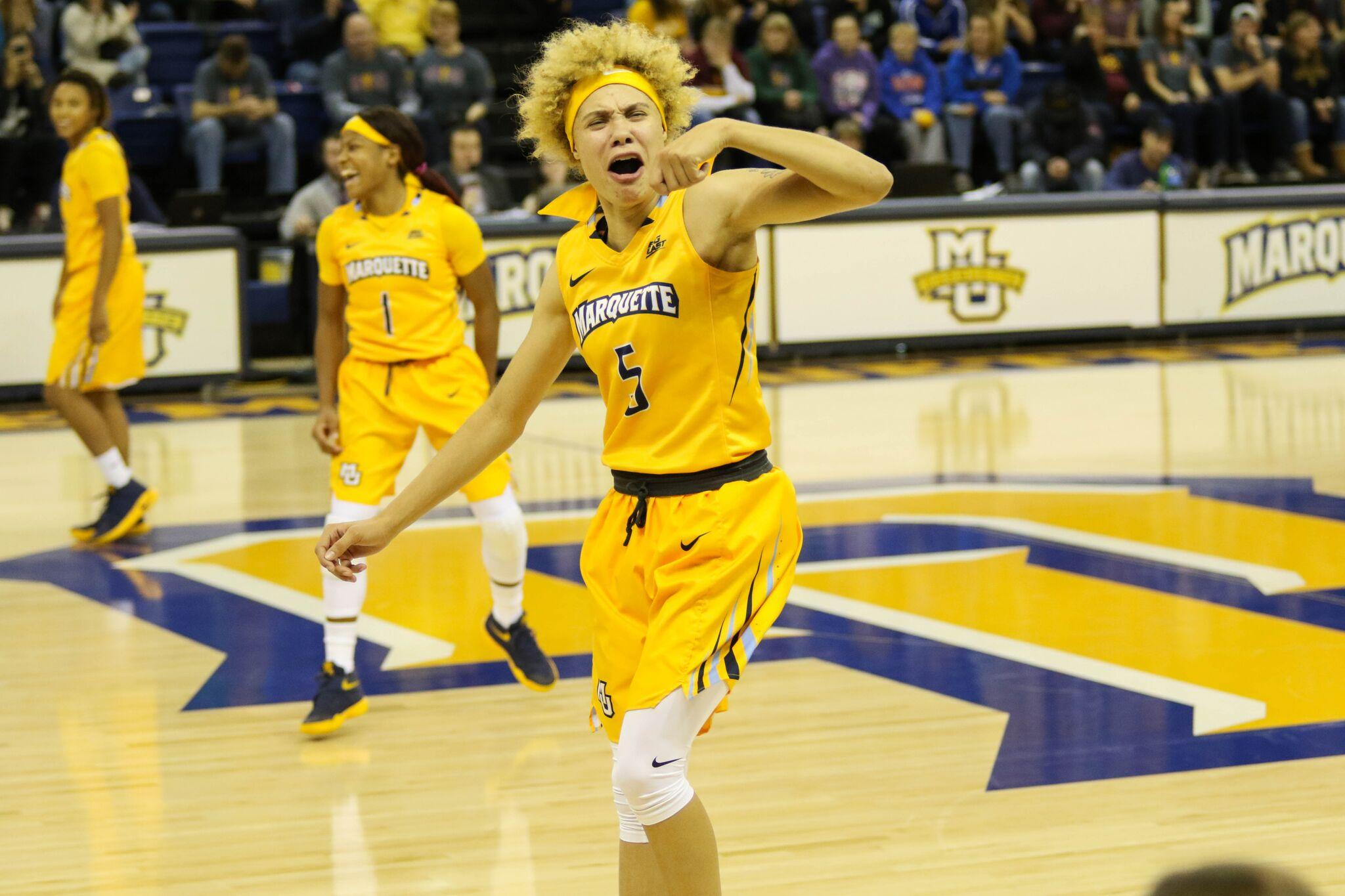 Natisha Hiedeman celebrates one of her 5 three-pointers in Marquette's 75-63 victory over Arizona State.