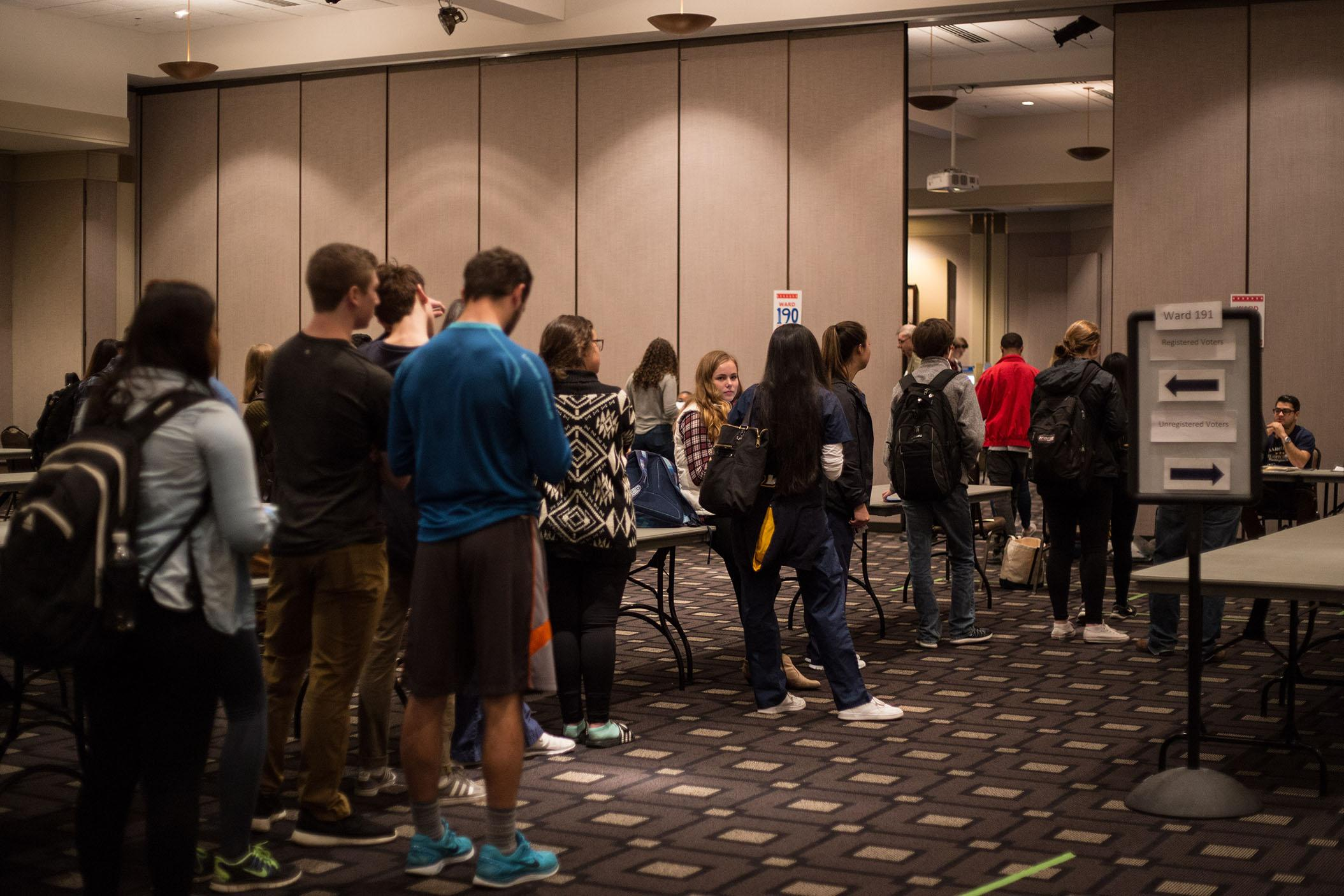 Students wait in line at the Alumni Memorial Union to vote.