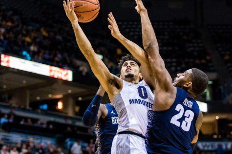Howard scores 23 in BIG EAST debut as MU outlasts Georgetown
