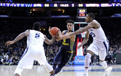 Markus Howard splits the defense in Marquette's first game against Villanova this season.