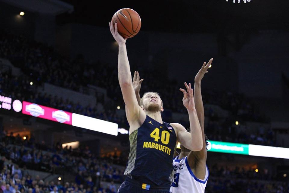 Luke Fischer goes for a basket during Marquette's 102-94 victory against Creighton.