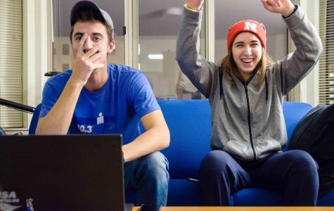 Steve Lewandowski, a sophomore in the College of Engineering, and Lou Hasebroock, a freshman in the College of Education, watch the latest episode of