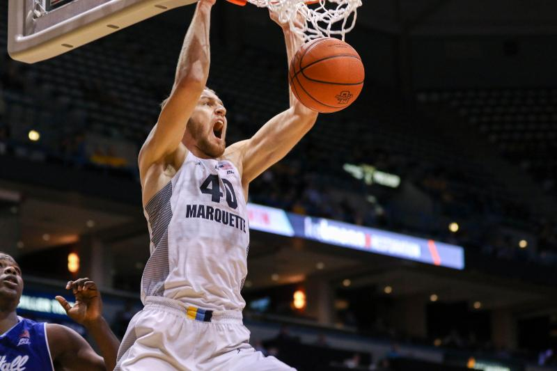Luke Fischer scored 14 points and grabbed eight rebounds in Marquette's victory against Seton Hall.