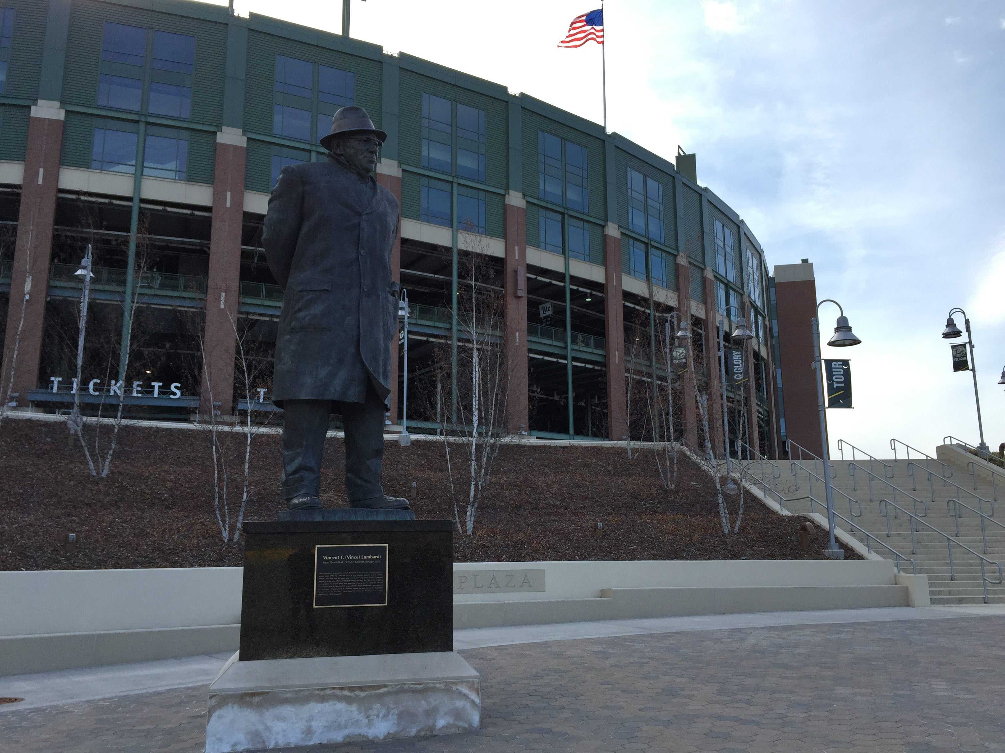 A statue of famous Packers head coach Vince Lombardi stands outside Lambeau Field in Caroline's hometown of Green Bay.