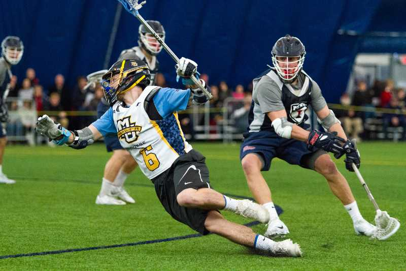Andy+DeMichiei+tries+to+evade+a+Penn+defender+in+Marquette%27s+scrimmage+Saturday.