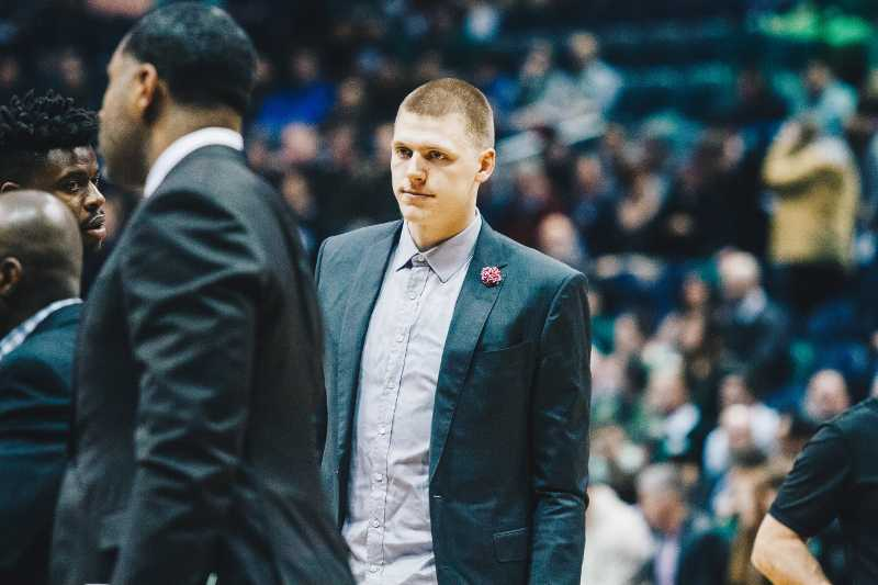 Henry Ellenson stands on the court at the BMO Harris Bradley Center before the Detroit Pistons game against the Milwaukee Bucks.
