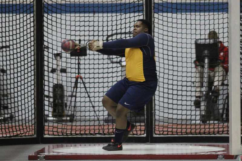 Joel McBride participates in the hammer throw at Madison in 2015.