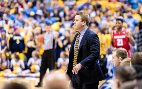 Steve Wojciechowski stands on the sideline during Marquette's game against Wisconsin.