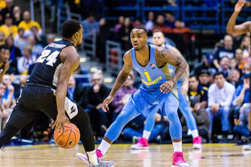 Duane+Wilson+guards+Kyron+Cartwright+during+Marquette%27s+game+against+Providence.