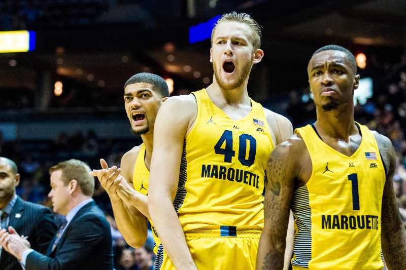 Marquette celebrates on the sidelines during a game against St. John's.