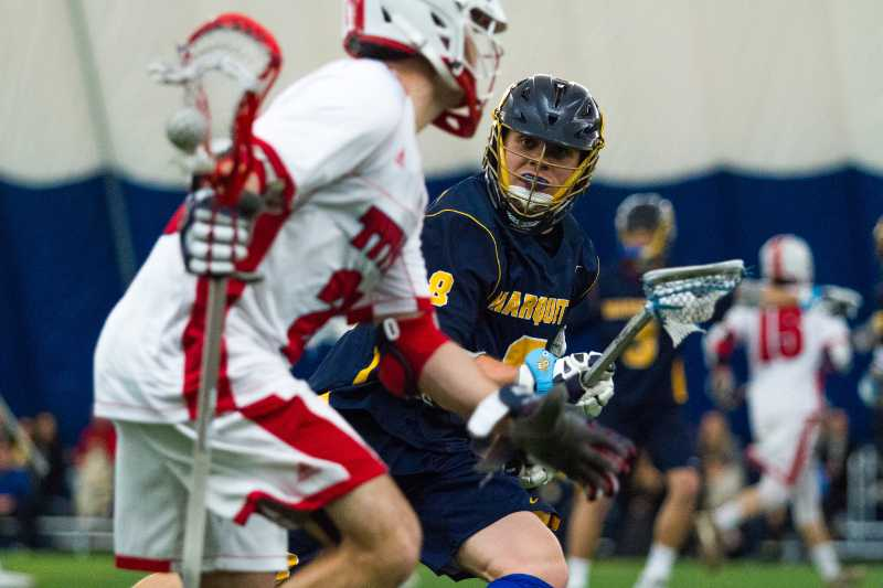 Nick+Grill+guards+a+Detroit+Mercy+attackman+during+Marquette%27s+game+Sunday.