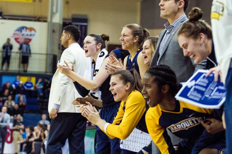 The womens basketball bench celebrates during the BIG EAST semifinal.