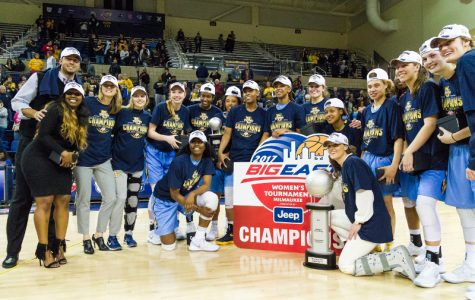 Women's basketball celebrates following their BIG EAST championship in March.
