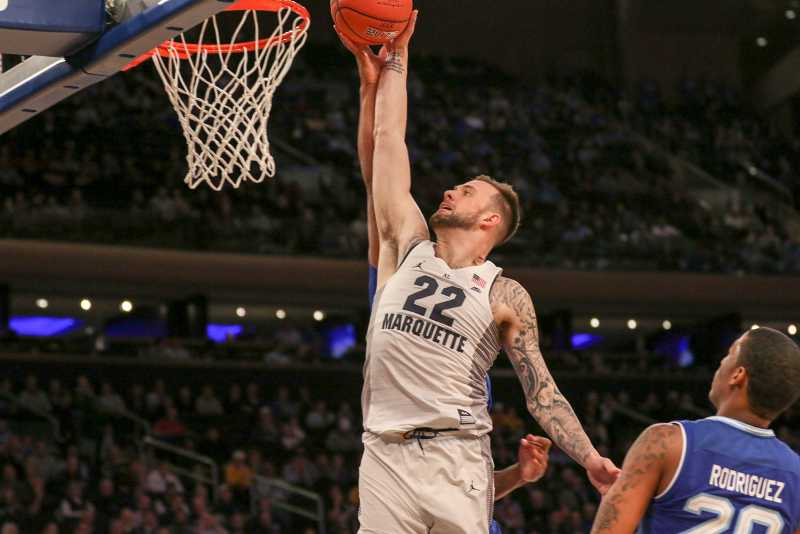 Katin Reinhardt goes in for a dunk in Marquette's BIG EAST Tournament game against Seton Hall.